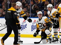 Jake Guentzel kneels on the ice after being injured by a hit from Buffalo's Rasmus Ristolainen on Tuesday.