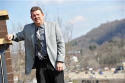 Murrysville chief administrator Jim Morrison stands at the entrance to Murrysville with U.S. Route 22 in the background.