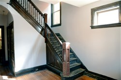 A view of the front staircase inside this home at 1136 Woodland Ave, in Marshall-Shadeland.