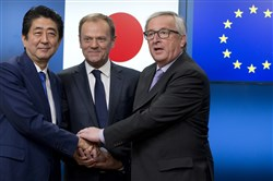 European Commission President Jean-Claude Juncker, right, and European Council President Donald Tusk, center, greet Japanese Prime Minister Shinzo Abe during a meeting at the Europa building in Brussels on Tuesday.