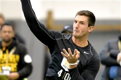 Pitt quarterback Nate Peterman throws during Pitt's pro day last month at the UPMC Rooney Sports Complex on the South Side.