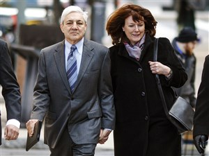 Former Penn State president Graham Spanier, second left, and his wife Sandra, arrive for the third day of his trial at the Dauphin County Courthouse in Harrisburg on Wednesday.
