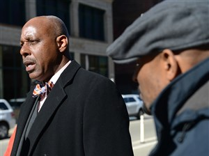 Rev. John Welch, left, with his campaign manager Rodney Lyde, right, holds a press conference outside PWSA headquarters Wednesday in the Strip District.