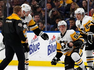 Jake Guentzel #59 of the Pittsburgh Penguins is injured after being hit by Rasmus Ristolainen of the Buffalo Sabres during the first period at KeyBank Center in Buffalo. Guentzel, who suffered a concussion, practiced with the Penguins Tuesday for the first time since he was injured.