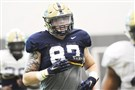 Tight end Chris Clark goes through a drill at Pitt's spring practice Thursday morning on the South Side.