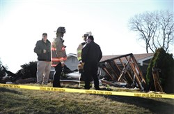 First responders survey the damage after a house explosion in Moon.