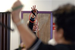 An instructor with Silver Sneakers leads class in a set of exercises in 2007 at the Plum Boro Senior Center. A new study says heart patients shouldn't use age as a barrier to proper exercise.