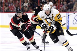Ottawa's Kyle Turris, left, chases Sidney Crosby during the first period of the Senators' victory on Thursday night in Ottawa, Ontario.