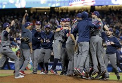 The U.S. team celebrates after defeating Puerto Rico 8-0 in the final of the World Baseball Classic in Los Angeles, Wednesday, March 22, 2017.