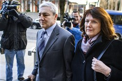 Former Penn State president Graham Spanier and his wife Sandra arrive at the Dauphin County Courthouse on Wednesday