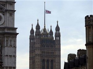 The flag above the Houses of Parliament flies at half-staff, the day after a terrorist attack in London, Britain, Thursday.