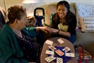 "Josie Andres, 89, of West Mifflin, laughs with Francine Barone as they play the ""Kings in the Corner"" car game during Ms. Barone's visit for her federal work-study program. Ms. Barone, a CCAC student, brings puzzles, games, books and conversations for her three-hour visits."