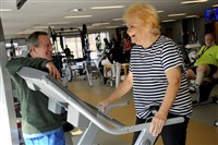 Dr. Michael Hagerty, medical director of the cardiac rehabilitation program at Allegheny Health Network's Wexford Health + Wellness Pavilion, chats Friday with patient Lorraine Kobert, 67. Ms. Kobert had open heart surgery in November.