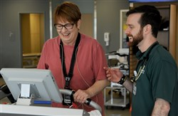 Nancy McLaughlin, 63, shares a laugh with J.D. Waechter of the cardiac rehabilitation program at Allegheny Health Network's Wexford Health + Wellness Pavilion. Ms. McLaughlin had an open heart surgery in August 2016.