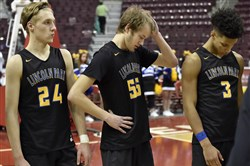 Lincoln Park's Evan Brown, Nick Antonucci and Keeno Holmes react after losing to Neumann-Goretti in the PIAA class 3A championship Thursday at the Giant Center in Hershey.