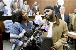 Ibn Ali Miller speaks as his mother Sabrina Winters, left, looks on at an Atlantic City Council meeting where he was honored Wednesday March 22, 2017, in Atlantic City, N.J. Millar, a New Jersey man who interrupted a street fight between two teenagers in a video that has drawn millions of views and wide praise, said Wednesday that he's saddened that his act of peacemaking isn't a more frequent occurrence.