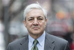 Former Penn State president Graham Spanier walks to the Dauphin County Courthouse in Harrisburg Friday.