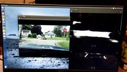"RoadBotics, is a service that uses windshield cameras to document conditions of roads. A monitor shows the street view, to the left , and the ""damaged"" area of the street to the right."