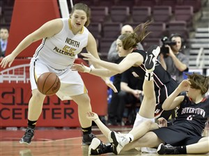 North Allegheny's Madlyn Fischer looks to get a loose ball against Boyertown's Victoria Boalton and Alli Marcus in the PIAA class 6A championship Friday at the Giant Center in Hershey.