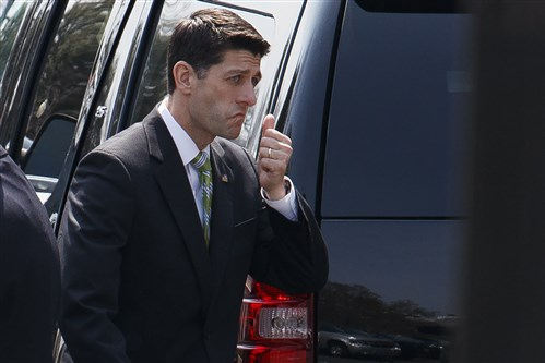 House Speaker Paul Ryan of Wis. leaves the White House in Washington, Friday, March 24 after meeting with President Donald Trump.