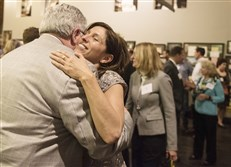 Suzanne Alexander receives a hug from Tim Davis at a Live Like Lou event to celebrate that the foundation has met its fundraising goal of $4 million at the Roberto Clemente Museum in the Strip District.