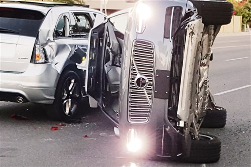An Uber Volvo on its side following a crash Friday, March 24, 2017 in Arizona.