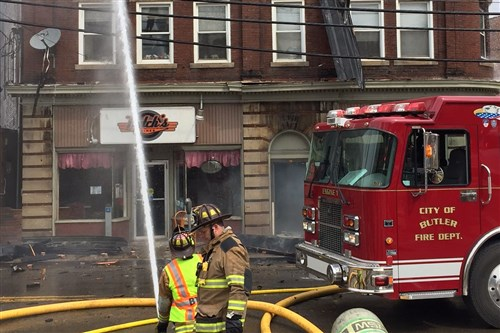 Firefighters battle a multi-alarm fire at an apartment building and diner in Butler City.
