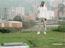 Pittsburgh rapper Wiz Khalifa standing in the Colombian cemetery where notorious drug lord Pablo Escobar is buried. The photo was posted to Khalifa's Instagram account.