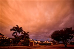 Storm clouds gather Monday in the town of Ayr in north Queensland as Cyclone Debbie approaches.