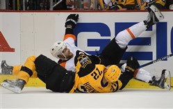 Penguins' Patric Hornqvist check Flyers' Andrew MacDonald in the first period at PPG Paint Arena.