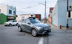 Operators ride inside one of Uber's self-driving SUVs on Monday along Penn Avenue in the Strip District.
