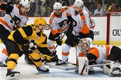 Philadelphia Flyers goalie Steve Mason makes a save on Penguins' Conor Sheary in the first period at PPG Paint Arena.