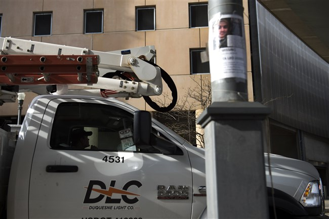 A Duquesne Light truck drives through the North Shore. Duquesne Light Co. has come to an agreement with regulators and consumer advocates on rate increases, the electric utility announced on Friday.
