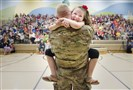 Second-grader Imogen Nowak cries in the arms of her father, U.S. Army Capt. Erik Nowak, during an assembly for National Kindness Week at Quaker Valley's Osborne Elementary School in Glen Osborne on Tuesday. Capt, Nowak has been in Qatar, Iraq, Kuwait, and Turkey since September 2016.