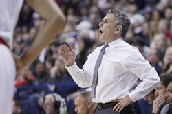 Keith Dambrot won more than 20 games in 12 of his 13 seasons with Akron. (AP Photo/Young Kwak)
