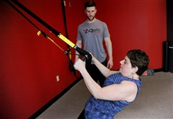 Adele Sufrin, 53, of Mt. Lebanon works out Tuesday with fitness coach Kyle Filipczyk at Connected Health in Pine.