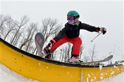 Drew Hooker, 12, of Greensburg, practices with the Pennsylvania Freestyle Ski Association in March at Seven Springs Mountain Resort.