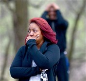 People react after a teenager was fatally shot Tuesday at the Linton Middle School playground in Penn Hills.