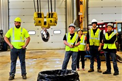 Allen Holl, left, a third-year apprentice, shows students from Lawrence County Career & Technical Center an overhead crane Tuesday during their tour of the Western Pennsylvania Operating Engineers Joint Apprenticeship and Training Center in New Alexandria, Westmoreland County.