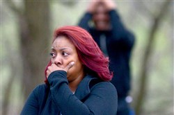 Bystanders react to the shooting death of a teenager outside Linton Middle School in Penn Hills Tuesday afternoon.