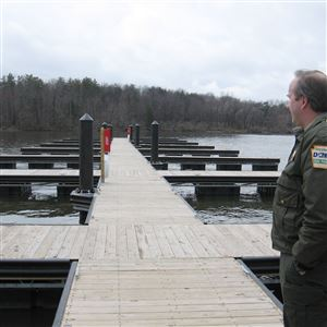 Park superintendent Dan Bickel looks over docks at Pymatuning State Park, after they were upgraded last spring. This spring there will be a new picnic shelter constructed near the dam In addition to improved camping facilities, paving and launch area.