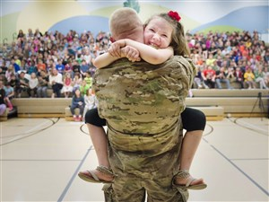 Second grader Imogen Nowak cries in the arms of her father United States Army Captain Erik Nowak after he surprised her during an assembly for National Kindness Week at Quaker ValleyÕs Osborne Elementary School in Sewickley on Tuesday, March 28, 2017. Captain Nowak has been in Qatar, Iraq, Kuwait, and Turkey since September 2016. (Steph Chambers/Post-Gazette)
