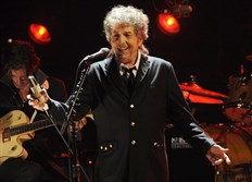 In this Jan. 12, 2012, file photo, Bob Dylan performs in Los Angeles. The Swedish Academy says 2016 Nobel literature winner Bob Dylan will meet with members of the academy this weekend and they will hand over his Nobel diploma and medal.
