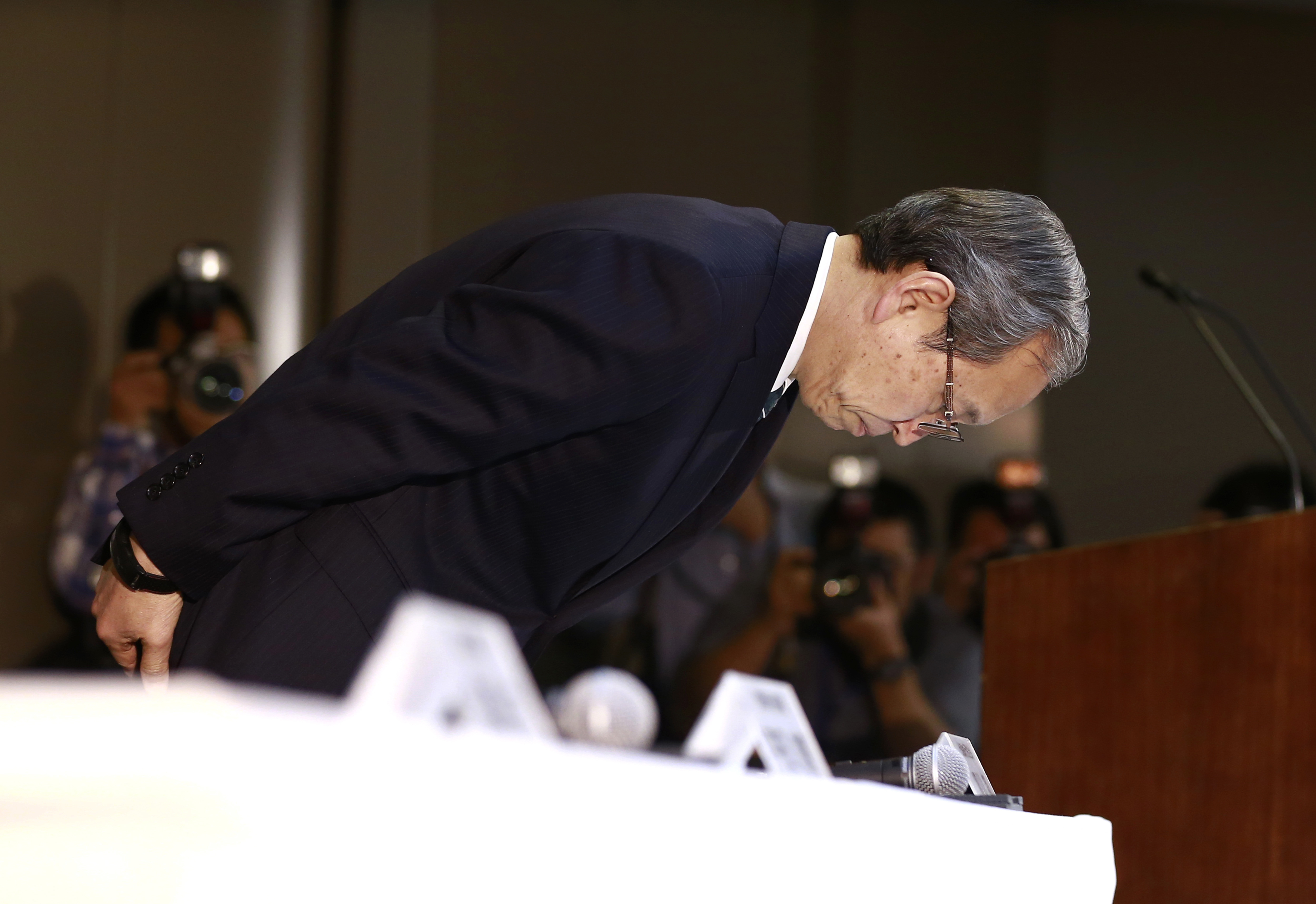 Japan Toshiba Westinghouse-1 Toshiba Corp. President Satoshi Tsunakawa bows during a press conference at the company's headquarters in Tokyo, Wednesday, March 29, 2017. Japan's embattled Toshiba said Wednesday that its U.S. nuclear unit Westinghouse Electric Co. has filed for bankruptcy protection. Toshiba said in a statement that it filed the chapter 11 petition in the U.S. Bankruptcy Court of New York. (AP Photo/Shizuo Kambayashi)