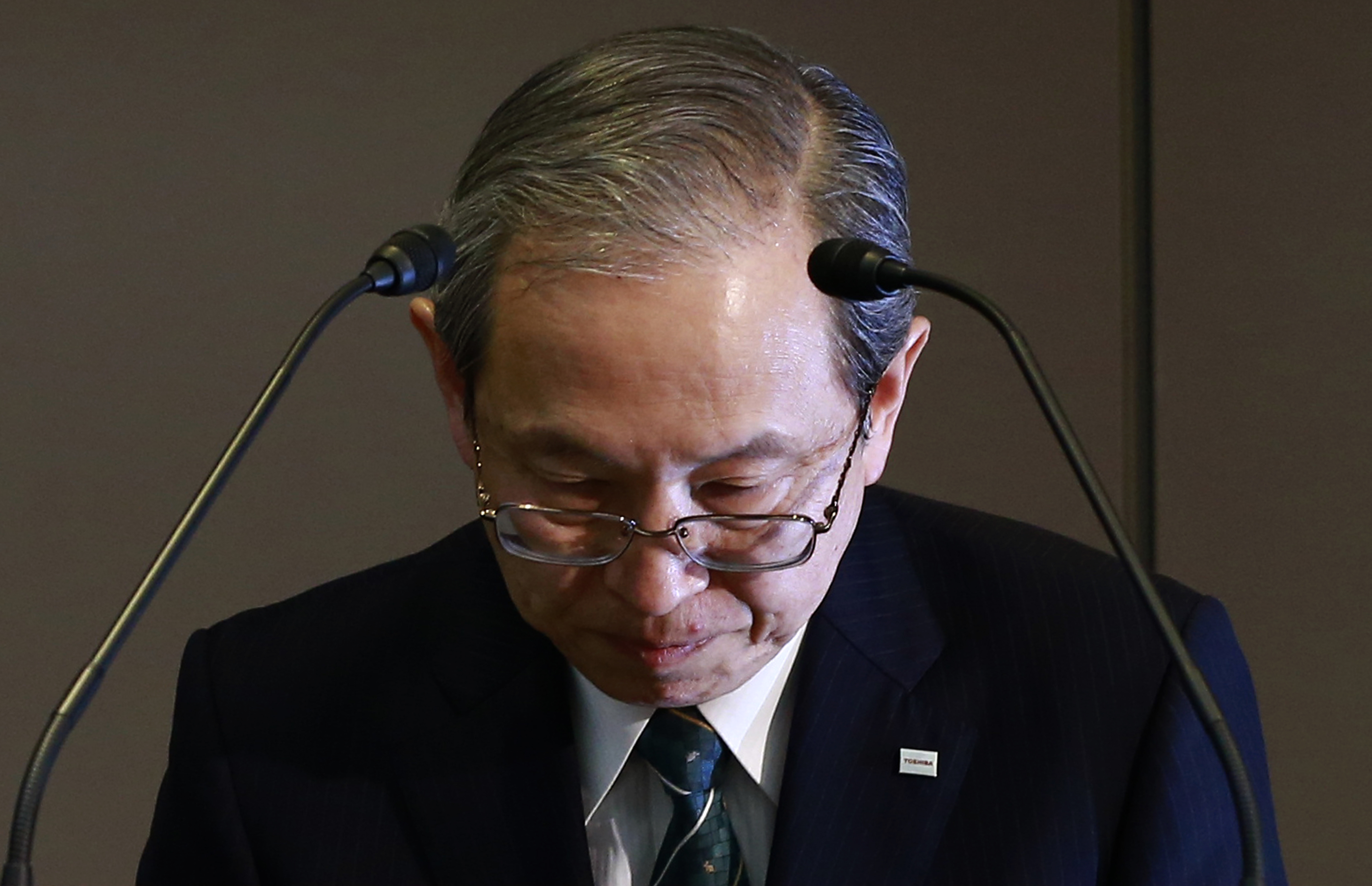 Japan Toshiba Westinghouse Toshiba Corp. President Satoshi Tsunakawa bows during a press conference at the company's headquarters in Tokyo, Wednesday, March 29, 2017. Japan's embattled Toshiba said Wednesday that its U.S. nuclear unit Westinghouse Electric Co. has filed for bankruptcy protection. Toshiba said in a statement that it filed the chapter 11 petition in the U.S. Bankruptcy Court of New York. (AP Photo/Shizuo Kambayashi)