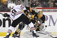 Marc-Andre Fleury makes a save on the Jonathan Toews.