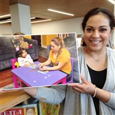 Carolina Genet holds one of the images she captured for the Ojo Latino photo project.