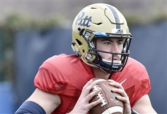 Pitt quarterback Ben DiNucci drops back to throw during spring practice last week at the UPMC Rooney Sports Complex on the South Side.