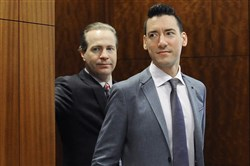 David Robert Daleiden, right, leaves a courtroom after a hearing in Houston on April 29.