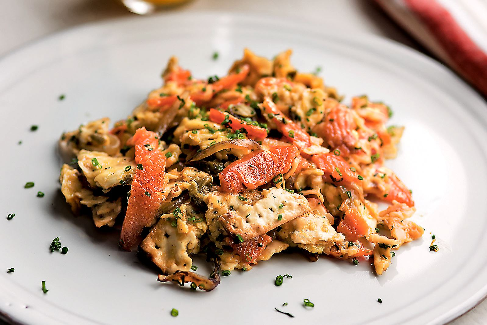 matzoh matza brei Matzo Brei, a perennial Passover breakfast, is enlivened with sauteed sweet onion and lox.